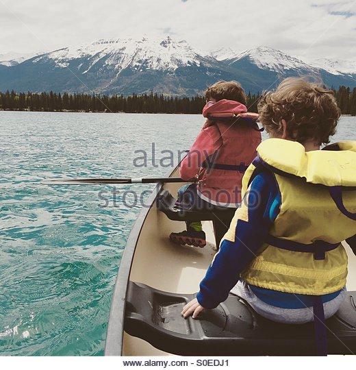 Canoeing in mountains. - Stock-Bilder