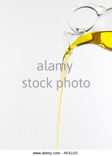 Pouring olive oil from carafe - Stock-Bilder