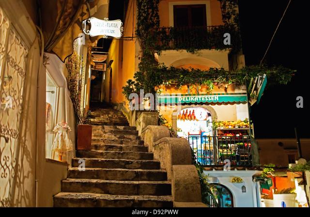 Food Market at Night on a Narrow Street, Positano, Campania, Italy - Stock Image
