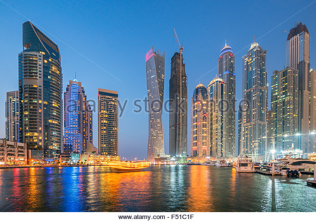 Skyline of skyscrapers  at night in  Marina district of Dubai United Arab Emirates - Stock-Bilder