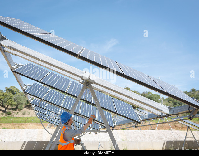 Spanish solar power station with worker - Stock Image