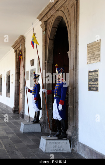 Ecuador Guards Presidential Palace Old town Quito city guard men entrance uniforms costumes traditional formal - Stock Image