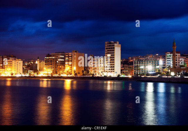 Lebanon, Sidon skyline at dusk - Stock Image