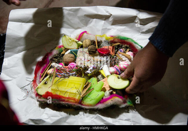 August in La Paz, Bolivia, witches or chifleras prepare an offering to the mother earth deity, la pachamama, to - Stock Image