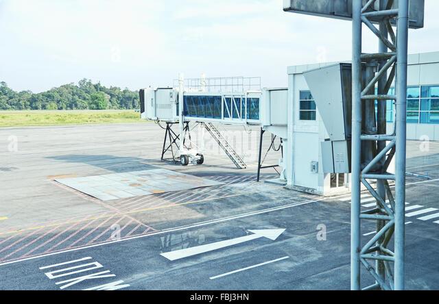A jet bridge in Kalimarau airport - Stock Image