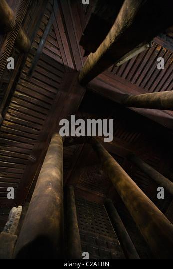 Bagaya Kyaung monastery, Amarapura, Myanmar, wooden columns and ceiling, low angle view - Stock-Bilder