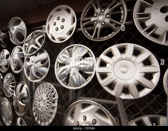 Dress up the car with a hubcap to look like a more expensive aluminum wheel. Wheels are round but the hubcaps vary - Stock-Bilder