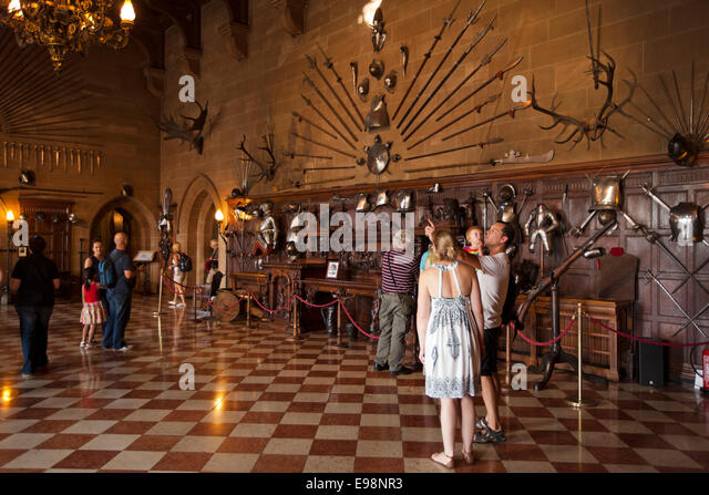 UK, England, Warwickshire, Warwick Castle, visitors in the Great Hall - Stock Image