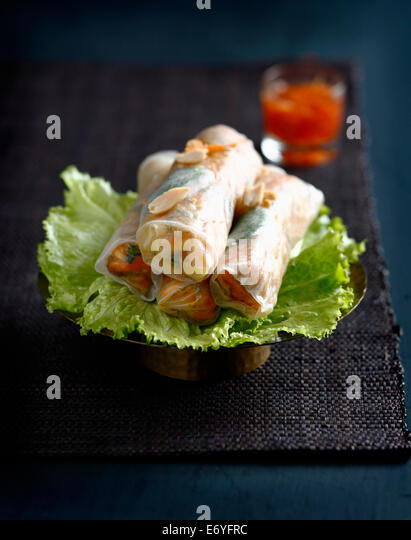 Pork,mint and peanut spring rolls - Stock Image
