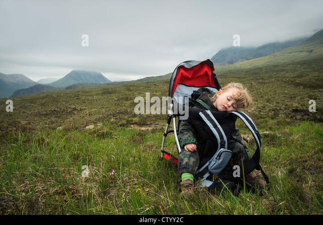 Toddler girl sleeping in carrier - Stock Image