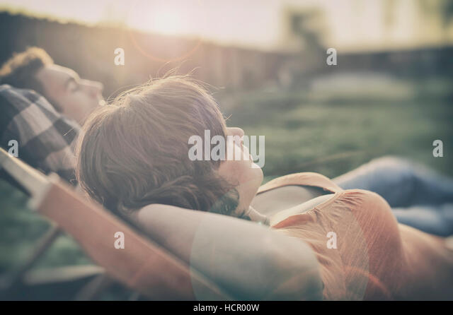 Couple resting on the couch - Stock Image