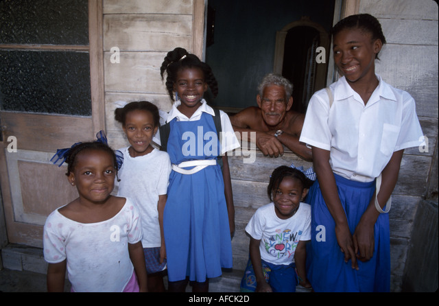 West Indies St. Lucia Anse Chastanet Resort Laborie Black female students school uniforms part Caribe Indian senior - Stock Image