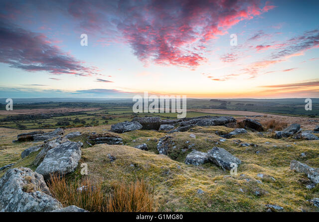 Stunning dramatic sunset over Bodmin Moor from the top of Alex Tor in Cornwall - Stock Image