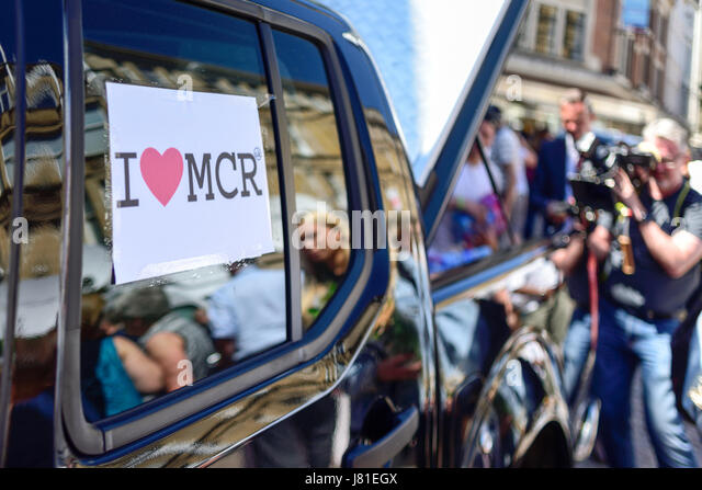 Manchester, UK. 26th May 2017. The ocean of floral tributes grows in St Ann's Square in the heart of the city - Stock Image