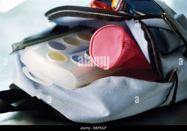 Backpack containing pencil case and watercolor paints - Stock-Bilder