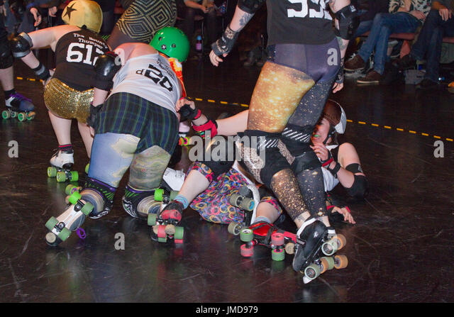 Pile up during a roller derby bout - Stock Image