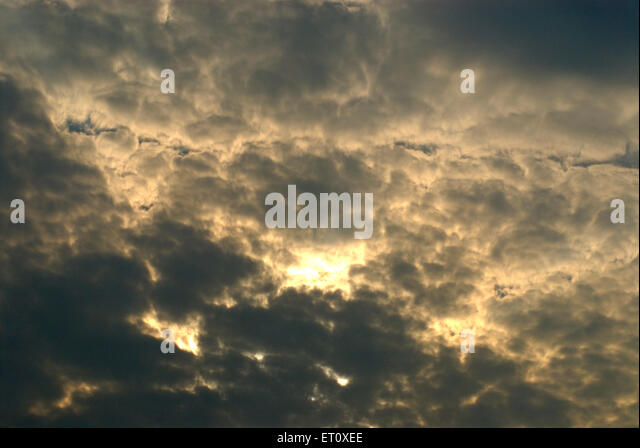 Colourful cloudy sky at sunrise ; Borivali ; Bombay Mumbai ; Maharashtra ; India - Stock Image