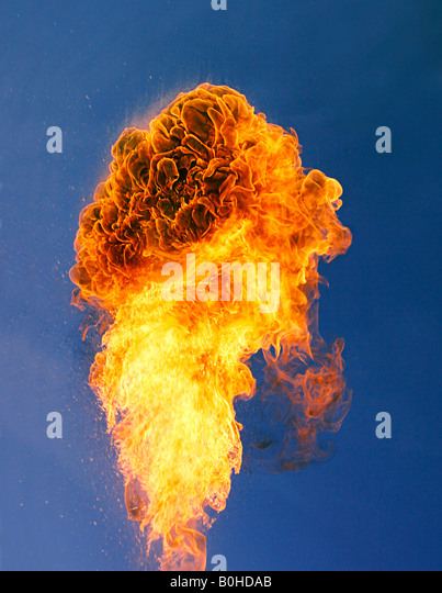 Large flame, column of fire rising from an explosion - Stock Image