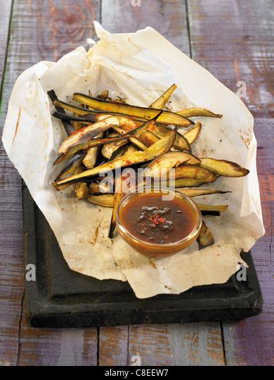 Spicy crisp fried eggplant strips - Stock Image