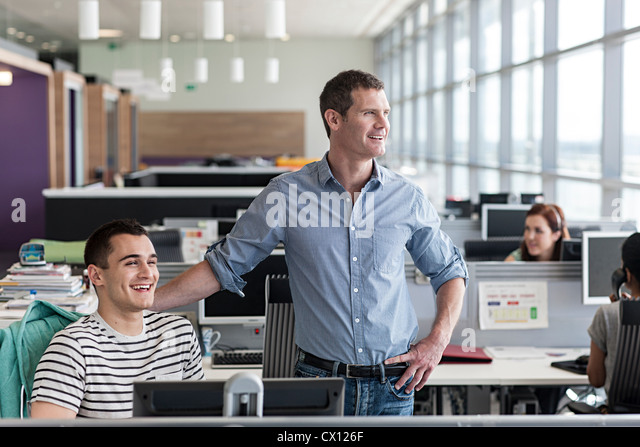 Two colleagues in office interior - Stock Image
