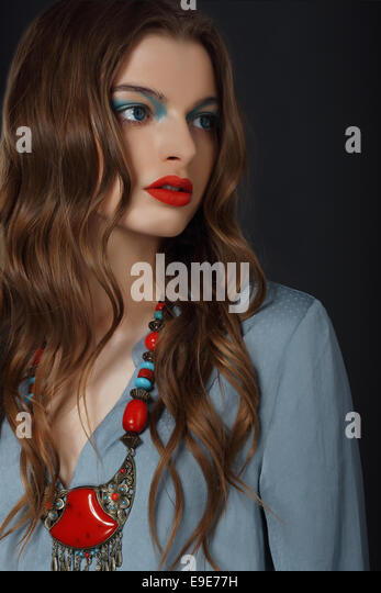 Young Woman with Bright Makeup and Necklace - Stock Image