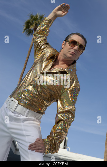 Low angle view of middle-aged posing against sky - Stock Image