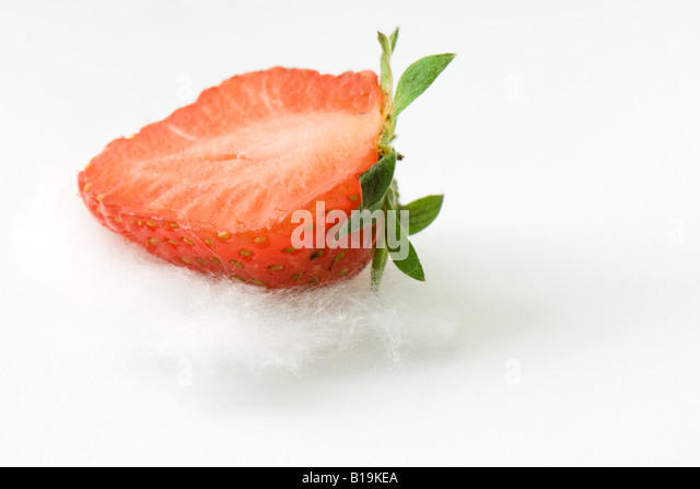 Fresh strawberry half on cotton, close-up - Stock Image