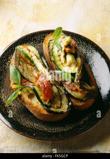 grilled vegetables on bread - Stock Image
