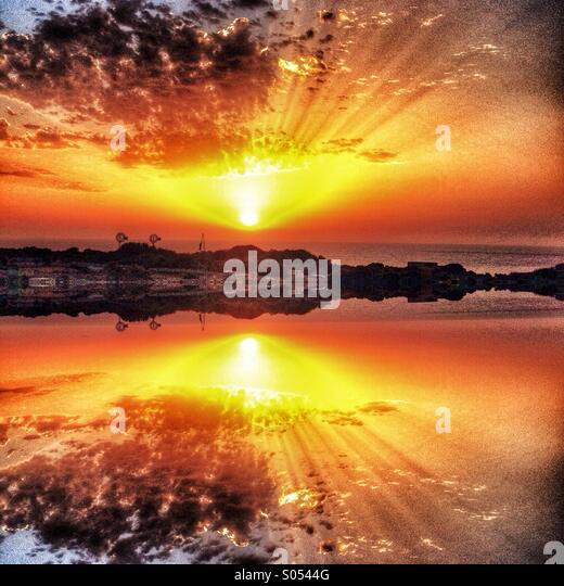 Surreal mirrored sunrise - Stock Image