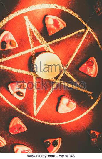 Gothic still-life in mysticism with a paranormal circle offering pizza slices in a ritual sacrifice - Stock Image