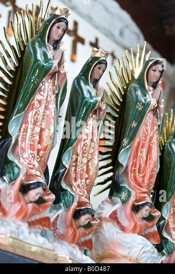 Statues in honour of the revered Virgin of Guadalupe. Seen throughout Mexico. Sold in a shop near the Basilica de - Stock Image