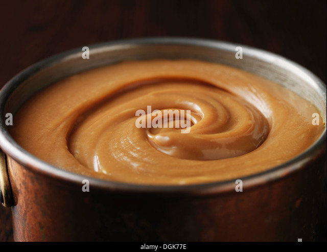 Still life with pan full of salted caramel - Stock Image