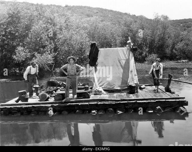 Clarence Muse, Jackie Coogan, Junior Durkin, on-set of the Film 'Huckleberry Finn', 1931 - Stock Image