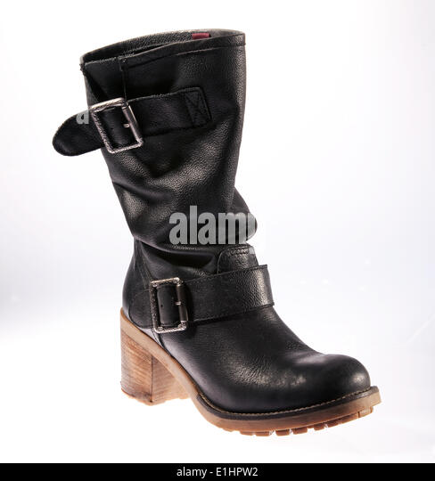 One black leather female boot isolated on white background - Stock Image