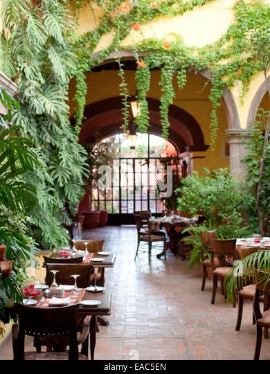 Courtyard dining room in San Miguel De Allende, Mexico - Stock Image