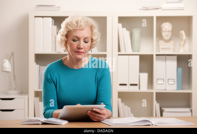 Senior woman using digital tablet - Stock-Bilder