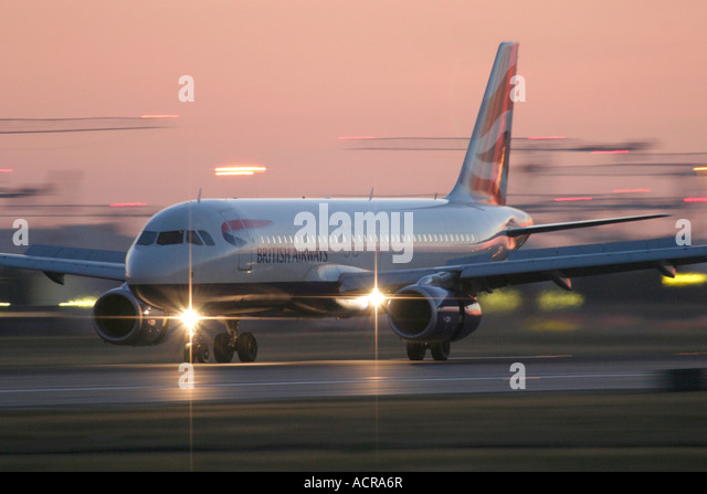 British Airways Airbus A320 late evening arrival at London Heathrow Airport England UK - Stock Image