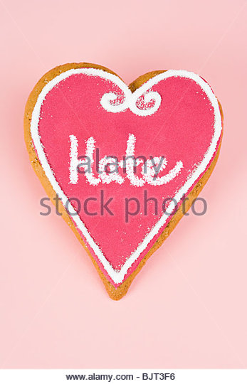 Hate written on heart shaped candy - Stock Image