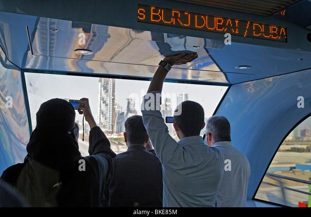 arabian women in new Metro line , Downtown Dubai, - Stock Image