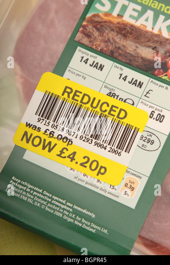 Reduced price label sticker on supermarket meat food packet due to sell by date - Stock Image