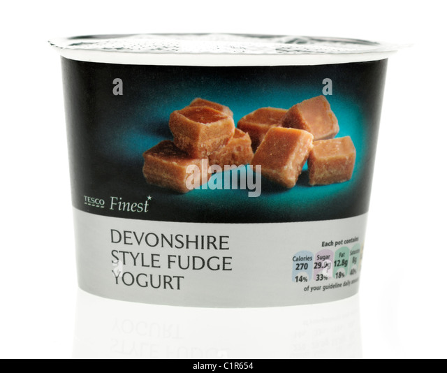 Carton of Tesco finest West Country Devonshire style fudge Yogurt made with British milk - Stock Image
