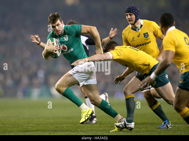 Ireland's Jared Payne is tackled by Australia's Bernard Foley (right) during the Aviva Stadium before the - Stock Image