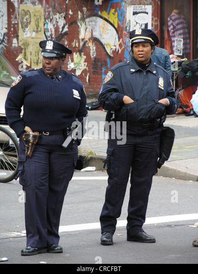 Two police officers with blue uniforms, USA, Brooklyn, New York City - Stock Image