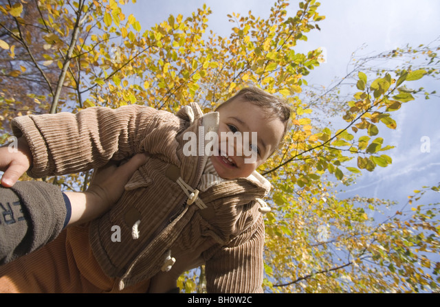 Child lifted up, Muenchen, Bavaria, Germany - Stock-Bilder