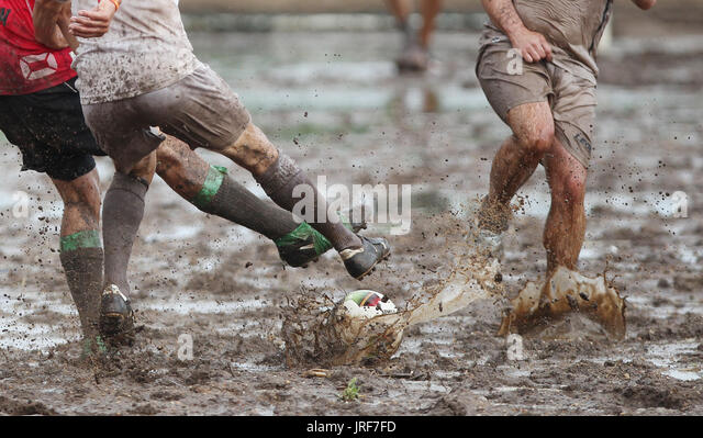 Wollnau, Germany. 05th Aug, 2017. Participants in the 9th German Mud Soccer Championship playing soccer in the mud - Stock Image