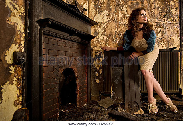 Caucasian Fashion Model in Burnt Building - Stock-Bilder