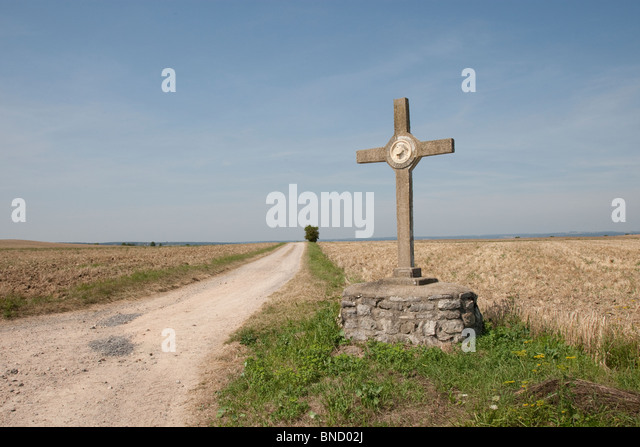 A Christian symbol at a road crossing in the Auvergne, France. - Stock Image