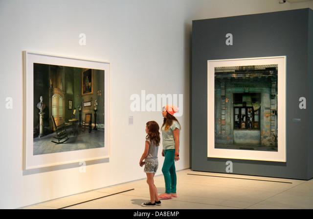 Tampa Florida Tampa Museum of Art gallery inside looking appreciating photographs teen girl sisters siblings - Stock Image