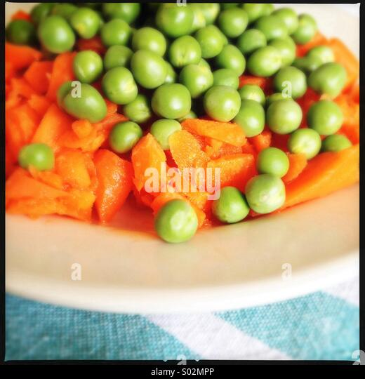 Raw Carrots and Peas - Stock Image