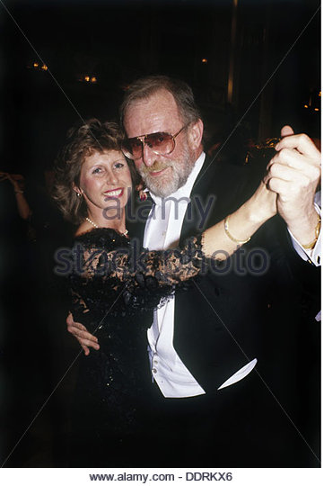 Rau Fritz 9.3.1930 - 19.8.2013 German concert promoter half length dancing with his wife Gisela early 1980s dinner - Stock Image